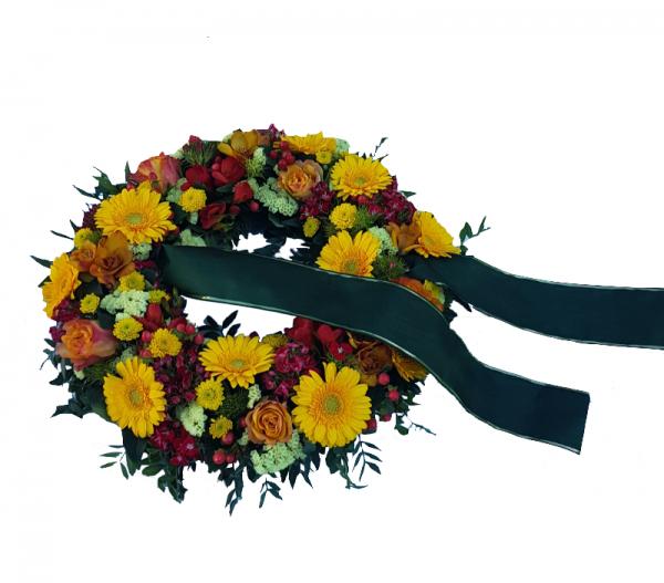 Trauerkranz in Gelb mit Trauerschleife